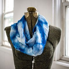 This hand-dyed indigo scarf features the Loom artisan Saleemah's signature stitch. Layer this versatile 100% Silk infinity scarf with your favorite dress or sweater to easily take you from day to night. #handmade #ethicalfashion