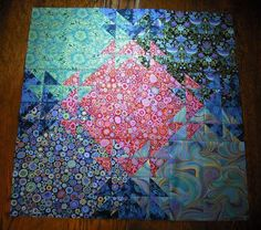 Detail sample of Shimmering Triangles pattern.  Lay out large squares on wall, then sew small triangles.