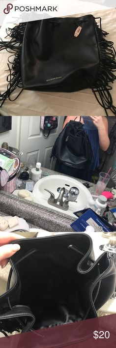 Faux leather VS backpack Drawstring black faux leather bag. New with tags, never used Victoria's Secret Bags Backpacks