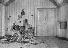 The basement where the Romanov family was murdered. The wall had been torn apart in search of bullets and other evidence by investigators in 1919. The double doors leading to a storeroom was locked during the execution.[