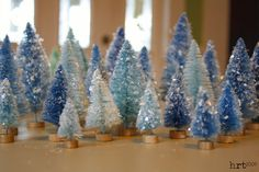 Dying Bottle Brush Christmas Trees - remove the wooden bases from the trees, let sit in a bleach & water bath. Christmas Crafts, Christmas Decorations, Christmas Ornaments, Holiday Decor, Christmas Mantles, Noel Christmas, Handmade Christmas, Victorian Christmas, Christmas Christmas