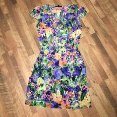 Jessica Simpson dress Very bright, multi-color, floral print dress. Worn once. Fits true to size. Cinched at the waist and has pockets. Jessica Simpson Dresses Mini
