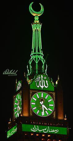 The Mecca Clock Tower Decorated for Ramadan Text رمضان مبارك Translation The LCD screen below the clock face says Ramadan Mubarak (Have a blessed Ramadan) http://islamicartdb.com/the-mecca-clock-tower-decorated-for-ramadan/