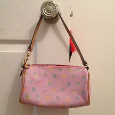 💯AUTHENTIC Dooney&Bourke bag! This is my first Dooney and Bourke I received! Very cute for a teenage daughter! Has a colorful zipper, a few marks but hardly noticeable, colorful signature logo! Dooney & Bourke Bags