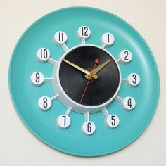 Spartus Wall Clock, c1950s--  (Hmmm... This makes me wonder-- small fifties clock on colored melamine plate?)