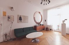 The right sense of reality & history: the Berlin home of artists Alicja Kwade and Gregor Hildebrandt with a pair of white brocade shoes on the wall and old police officer painting.