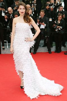 Model Laetitia Casta goes for it in an asymmetrical, embellished, strapless Christian Dior.