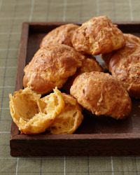 Guests at Bar Boulud are greeted with these golden French cheese puffs, with grated Gruyère cheese and the mild Basque pepper Piment d'Espelette. Almost twice the size of ordinary gougères, they're a bit like crispy, cheesy, slightly spicy popovers.    Need a gift check out WhatnotGems.com