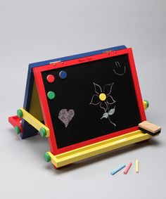 Any room can become a mini Matisse's art studio with this tabletop easel in their arsenal. Equipped with a magnetic chalkboard side and a dry erase side, this smart piece lets them experiment with multiple art mediums. Just set it on the table and watch their creativity flourish.