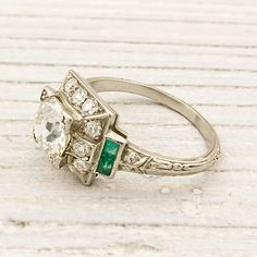 Vintage diamond and emerald engagement ring. Beautiful.