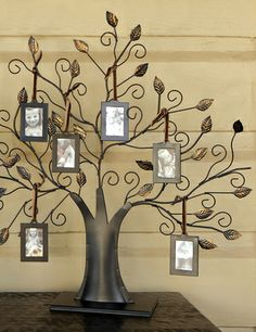 Metal Family Tree with Frames. Gather the whole together in this decorative family tree. Featuring 6 individual frames hanging from a metal table tree, this unique way to display your family's pictures will keep those you love close by. Displaying Family Pictures, Family Photos, Hallway Inspiration, Lds Art, Wall Lights, Ceiling Lights, Home Decor Shops, Candle Sconces, Home Art