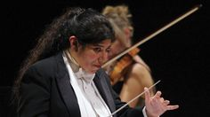 """""""If they hold an instrument, they will not take a drug. They will not hold a gun,"""" says Santa Cecilia Orchestra conductor Sonia Marie De Leon De Vega. """"It's that powerful."""""""
