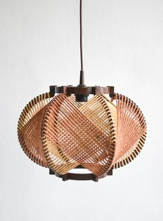 RESERVED Vintage hemp rope pendant lamp shade  Rustic string lamp from the late 1960s / early 70s with a natural look in brown. The lamp fits perfectly into your kitchen when hanged higher or into your lounge like living room when you hang it a bit lower. The string throws an interesting pattern on the walls. The lamp is in excellent condition.  Each country has different wiring requirements and hardware. Please check your local regulations. I would advise to have them installed by an…