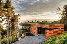 """Malbaie V Residence Modern wood architecture surrounded by a peaceful landscape. The """"Malbaie V Residence"""" in Cape à l'Aigle in Charlevoix, Quebec is Modern Architecture House, Sustainable Architecture, Residential Architecture, Modern House Design, Amazing Architecture, Interior Architecture, Landscape Architecture, Architecture Journal, Building Architecture"""