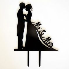 """""""Give your cake a timeless look with this bride and groom silhouette cake topper. With a romantic and vintage style, this cake topper features Mr. & Mrs. in cursive font for an elegant touch."""