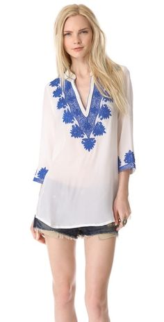 Love this white tunic with blue embroidery. Would look great with white denim or as a swim coverup!