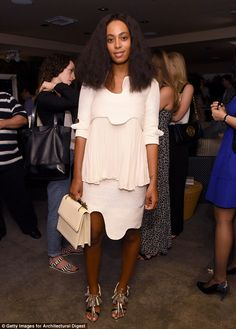 Dressed to frill: Solange Knowles arrived at the AD Oasis at James Royal Palm Hotel in a pretty frilled white dress and ornate heels on Thursday night