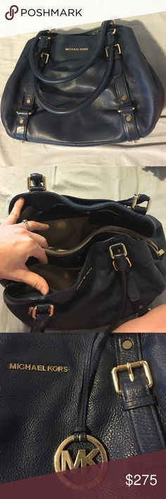 Michael Kors leather bag Large MK carry all bag withe three large interior compartments and tons of small storage pockets! Beautiful navy color soft pebble leather with gold hardware. Includes gold MK charm/keychain. Gently used but in excellent condition with no flaws. Michael Kors Bags Shoulder Bags