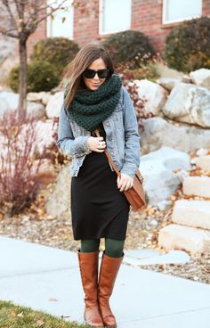 I like these colors. Black dress, dark green tights and scarf, brown boots and purse, and denim jacket.