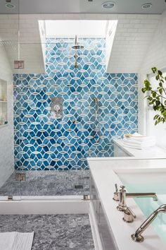 Photos Hgtv Blue Patterned Tile Accent Wall In Spacious Glass Door Shower With White Subway Walls And Gray Marble Flooring. handmade chandeliers. art deco wall. beautiful small bathrooms. blue wall colors. mirror headboards.