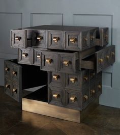 Multi-drawer, 40 brass handles, sandblasted and ebonized oak 33