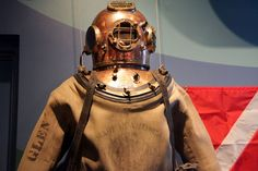 A 1930s-era commercial diving suit is displayed at the new National Museum of the Great Lakes in Toledo. The museum provides historical, archeological, commercial and meteorological information and provides many interactive exhibits for adults and children. (Lynn Ischay/The Plain Dealer)