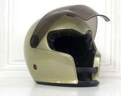 French helmet designer and manufacturer Ruby is showing a different helmet concept, especially created to match the striking silhouette of another French project: the Peugeot electric race car dubbed the Motorcycle Helmet Design, Scooter Motorcycle, Motorcycle Girls, Riding Gear, Riding Helmets, Peugeot, Ruby Helmets, Helmet Head, Karts