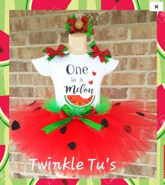 "Your little one will have a ""One in a Melon"" Birthday in this Watermelon Tutu Outfit! Includes tutu, shirt, and hairbow. Shirt is made with a vinyl image and is personalized with child's name and age"