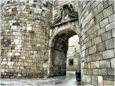Perfectly preserved ancient Roman gate in Lugo, Spain. Lugo is the only city in the world to be surrounded by completely intact Roman walls from 3rd century AD.