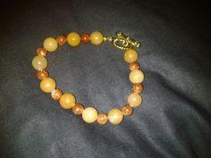 7 inch Goldstone and orange jade bracelet by RocksandRavels, $35.00