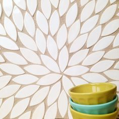 Fresh and innovative tile - we love thinking of new ways to use our shapes of tile! What would you call this tile pattern? Petals - 11 Deco White #tile #homedecor #handmade #local