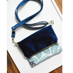Navy Blue Allenby Floral Fold-over Cross body bag. Front Pocket. Long Adjustable strap. Upcycled Boho Chic by juanitatortilla on Etsy https://www.etsy.com/au/listing/576676447/navy-blue-allenby-floral-fold-over-cross