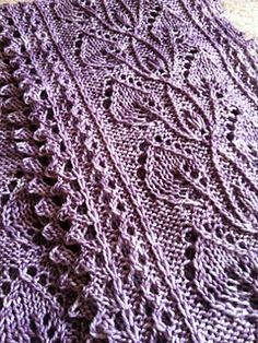 Smokeberry is an infinity scarf that features a beautiful mix of twisted stitches, cables, and lace. A provisional cast-on is used, then the scarf is worked lengthwise, and a 3 needle bind-off joins the ends.