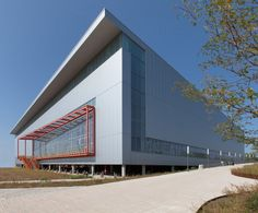 Image 1 of 19 from gallery of Ocean Breeze Track & Fieldhouse / Sage and Coombe Architects. Photograph by Alexa Hoyer Parque Industrial, Factory Architecture, Indoor Track, Warehouse Design, Water Management, Construction, Metal Buildings, Parks And Recreation, Building Design
