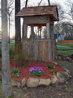 Wishing well made from barn wood.