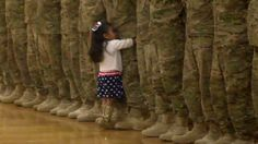 2-year-old girl sweetly interrupts homecoming ceremony to hug military dad