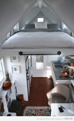 I love lofts now....mine is awesome...this is such a small space though and look how well it works....hmmmm need to rearrange my home...