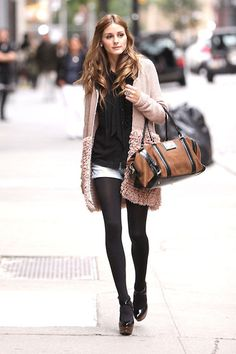 chunky beige cardigan over black shirt with white shorts, tights and boot heels