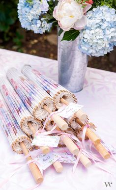 These white paper parasols with vintage floral print design is the perfect accessory for a wide range of wedding styles. Whether used to shade the suns rays or as a decorative photo prop, these parasols will add a pretty, romantic flair.