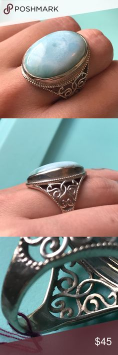 Silver Gemstone Ring Beautiful quality unknown blue stone set in a bright 925 silver setting. Cute, feminine details. About a size 8. Would look so cute mixed with other silver rings or by itself as a statement ring! Spring/ summer style. Unknown brand, tagged KS for exposure. 🌱 Feel free to ask any questions. Make an offer! All items must go. Check out my closet for more! 🌱 Jewelry Rings