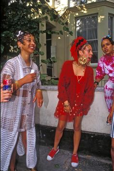 """1994, """"The Ragga girls in St Luke's Road just happened to be walking down the road, I gestured to photographed them and they obliged, then they simply melted into the crowds"""""""