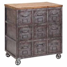 With a card catalog-style silhouette and caster feet, this wood and metal chest brings industrial flair to any room.