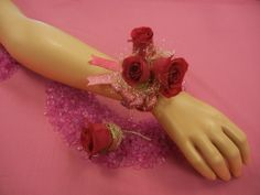 Flowers By Frances: Hot pink sweetheart rosese, silver angel hair, and pink ribbon. Corsage and matching boutonniere designed using customers ideas.