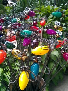 lightning bug garden decorations. Now we know what to do with all of our burnt out Christmas light bulbs.
