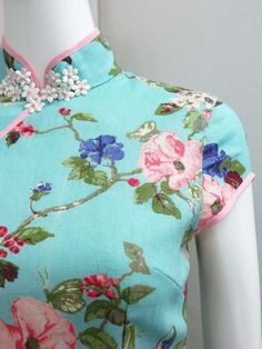 Spring 2013. Our classic cheongsam dress in vintage English garden prints. The mandarin collar boasts our signature floral applique detail adorned with Swarovski pearls. Absolutely classic and ladylike. Selling out!