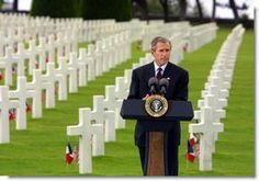 President George W. Bush gives a Memorial Day at the Normandy American Cemetery at Normandy Beach in France on May 27, 2002. White House pho...