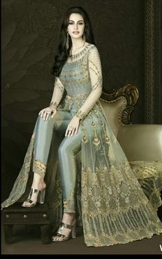 You Will Definitely Earn Lots Of Compliments Wearing This Heavy Designer Floor Length Suit In Grey Color Paired With Grey Colored Bottom And Its Rich Color And Is Making The Suit Attractive. Indian Designer Outfits, Indian Outfits, Designer Dresses, Designer Salwar Suits, Designer Anarkali, Indian Gowns Dresses, Pakistani Dresses, Net Dresses, Fashion Pants