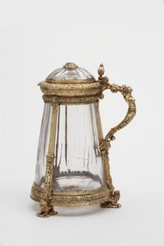 Tankard by Krug, Dieboldt, 3rd quarter 16th century, carved crystal; cast, chased, soldered, engraved gilded silver (silver-gilt); cameo and mirror - http://collections.vam.ac.uk/item/O156298/tankard/?print=1