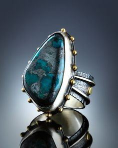 Fabricated sterling silver and 18k gold ring set with old stock Chrysocolla and Hematite from Arizona. The stone measures 1 inch by 5/8 inch at its