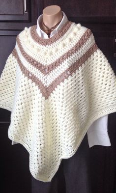 Crochet poncho. // THE TOP IS PRETTY, BUT I THINK WITH ALL THE BEAUTIFUL PATTERNS OUT THERE, MAYBE SOMETHING A LITTLE DIFFERENT FOR THE BOTTOM! ♥A: